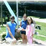 Bella (in blue) and Adriana (in pink) are presenting a check for $52 to Terry Craft from money they earned selling donut holes at the Farmer's Market while visiting with their grandmother for the summer!  Thanks so very much!